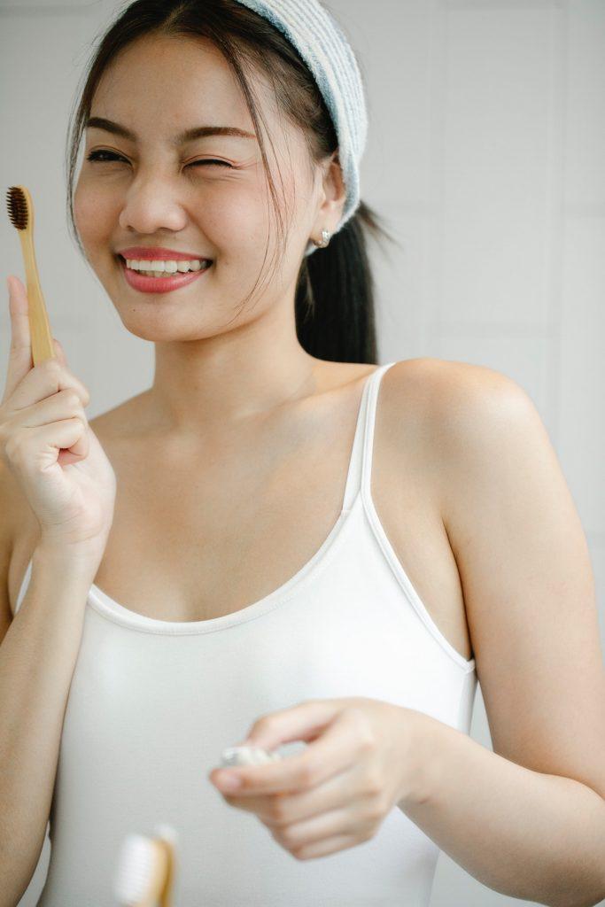 woman taking care of her teeth